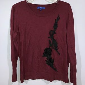 Burgundy sweater with floral sequin appliqué